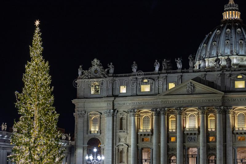 Piazza San Pietro, the nativity scene realized with the sand of Jesolo, and the Christmas tree decorated with gold-colored lights. royalty free stock images