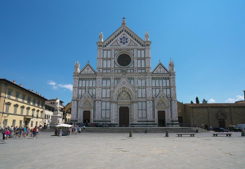 Piazza Santa Croce and Basilica di Santa Croce di Firenze in the blazing midday sun royalty free stock image