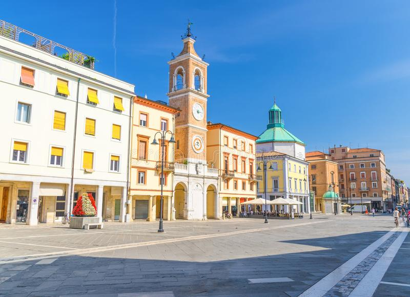 Piazza Tre Martiri Three Martyrs square with traditional buildings with clock and bell tower in Rimini stock photography