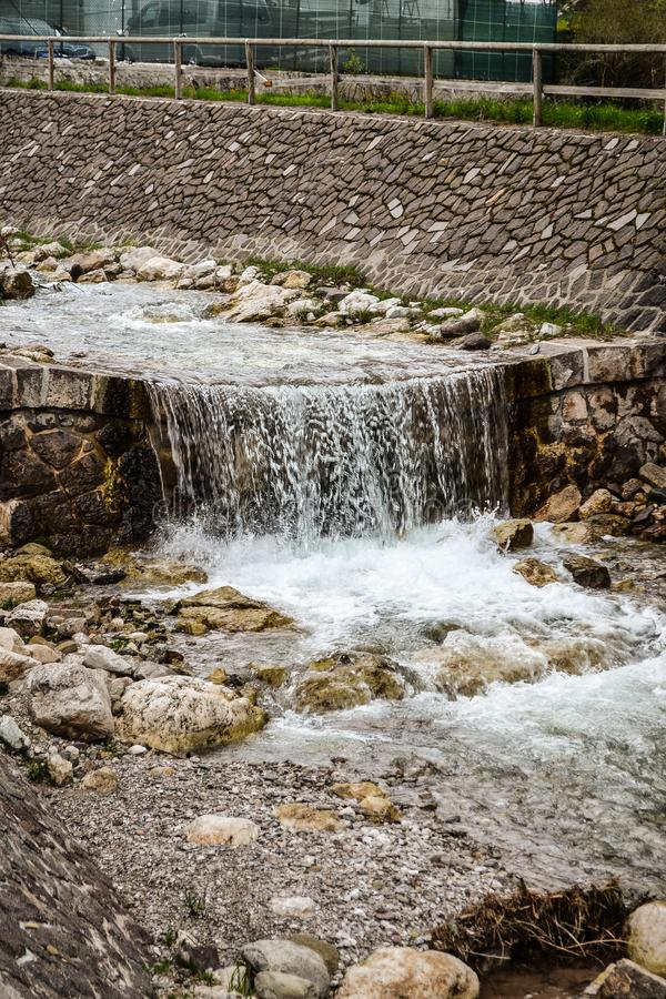 Small waterfall in the city stock photos