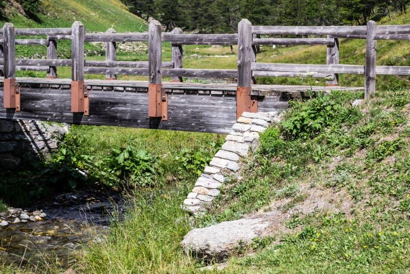 Wooden bridge and mountain stream stock photos