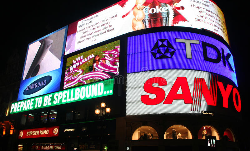 Download Piccadilly Circus editorial photo. Image of brands, english - 15240381