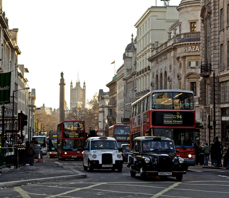 Piccadilly Circus London. Cabs and bus in Piccadilly Circus area of London