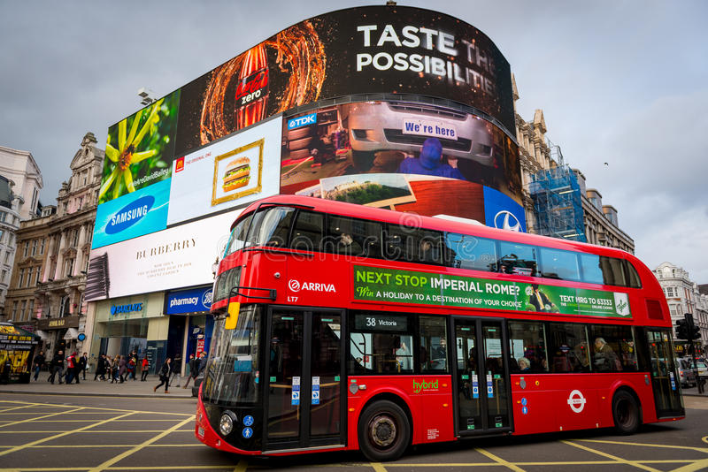 Piccadilly Circus with London Bus in Jan 2014. Iconic red London Bus passing by the popular tourist attraction Piccadilly Circus on Jan 2014 stock image