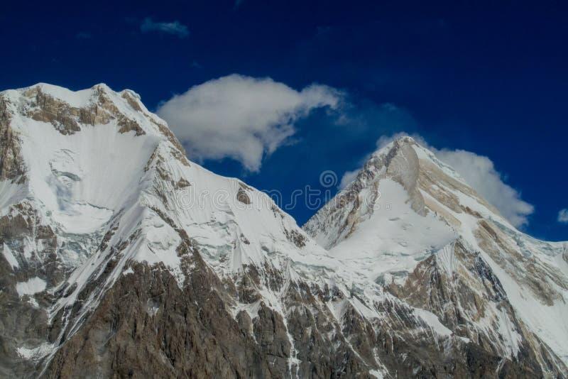 Picco di Khan Tengri in montagne di Tian Shan immagine stock libera da diritti