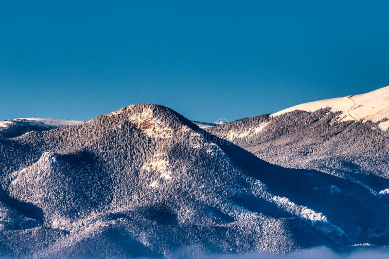 Picco di montagna di Snowy Front Range Neat Pikes Peak Cameron Cone fotografie stock