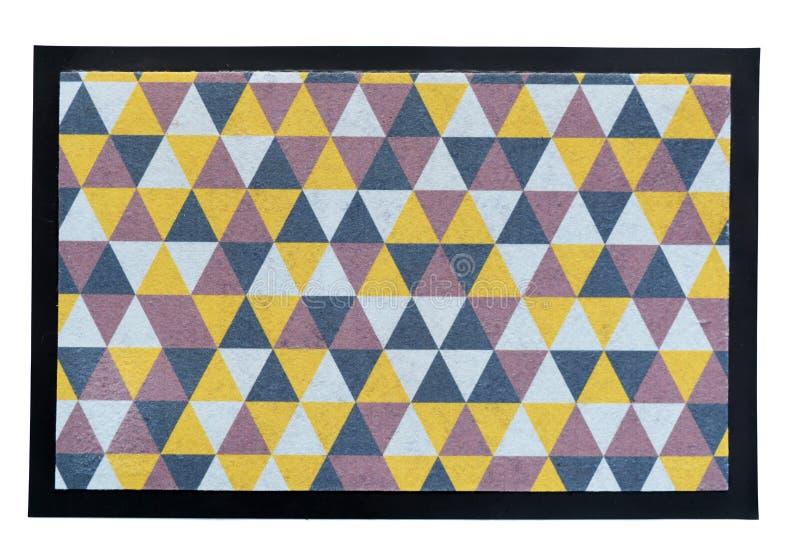 Piccola coperta variopinta della stuoia del tappeto del pavimento su bianco fotografie stock libere da diritti
