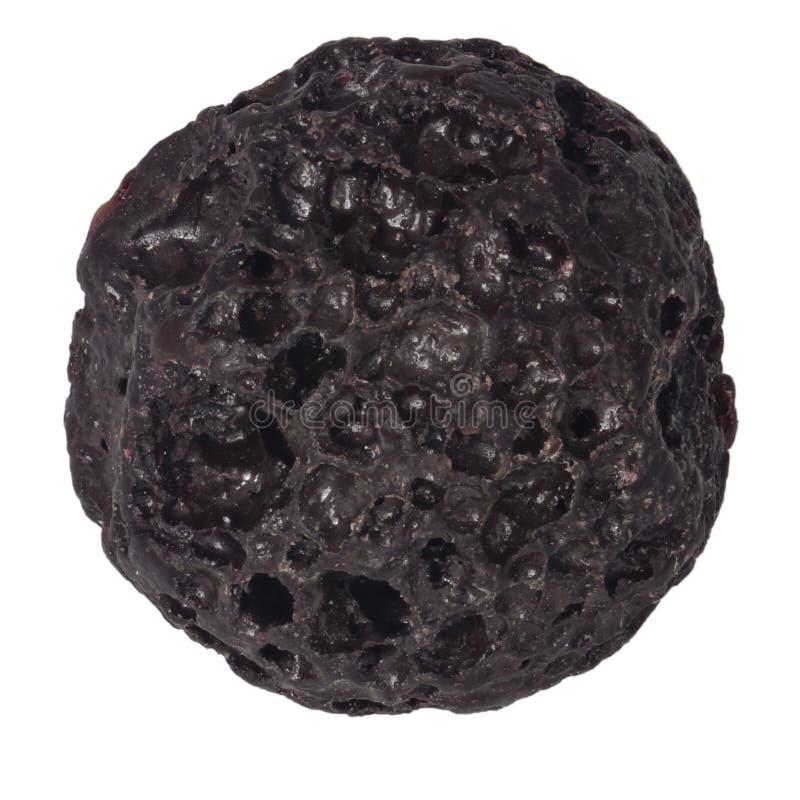 Piccola macro naturale marrone della perla della lava isolata su fondo bianco fotografia stock libera da diritti