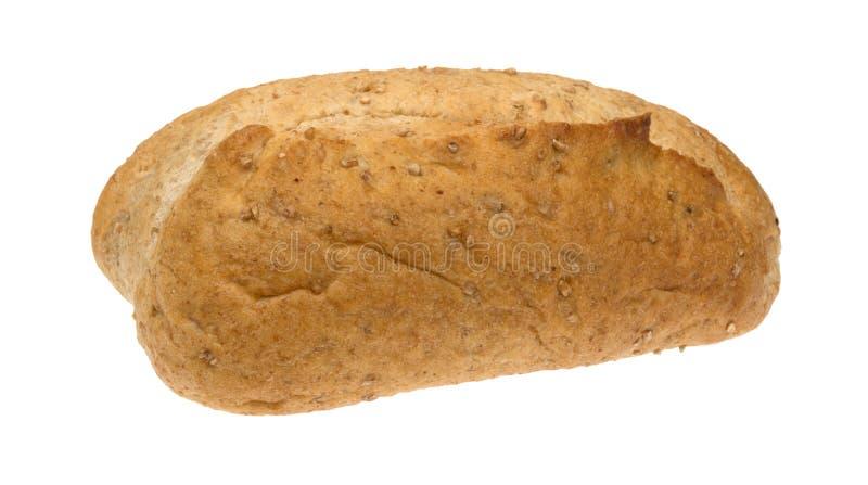 Piccola pagnotta del pane integrale su un fondo bianco fotografie stock