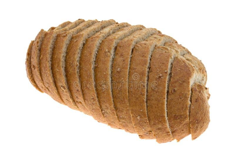 Piccola pagnotta di pane integrale affettato fotografia stock