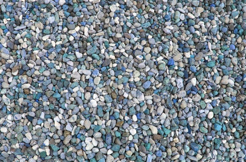 Piccola struttura del fondo delle pietre in spiaggia immagine stock libera da diritti