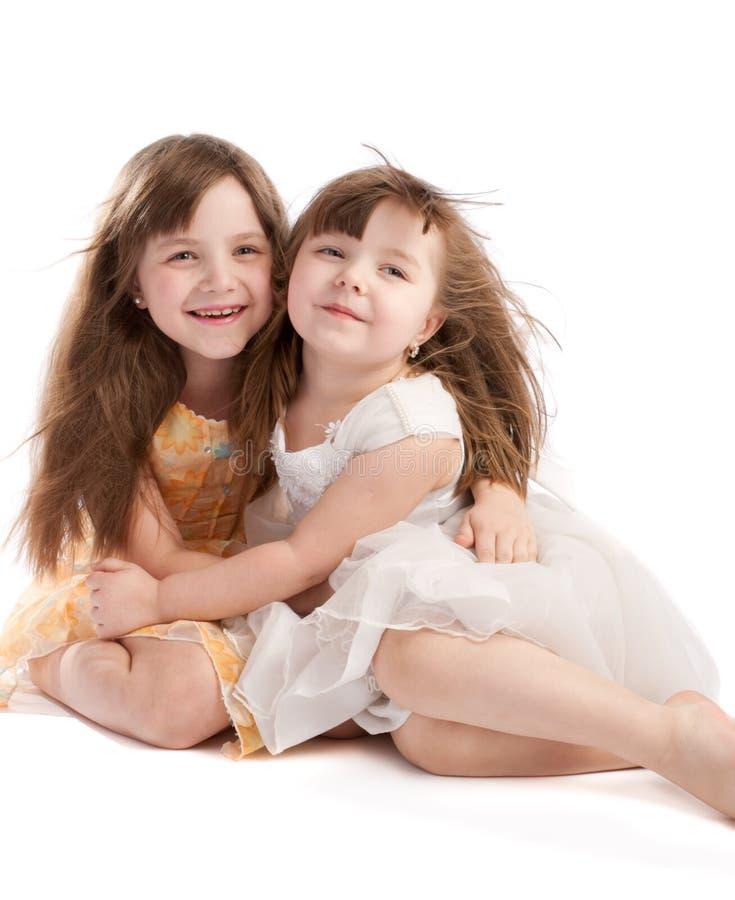 Piccole sorelle immagine stock