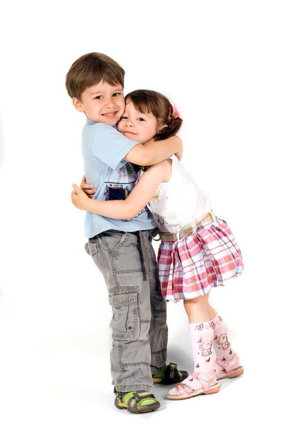 Piccoli bambini allegri isolati su bianco fotografia stock