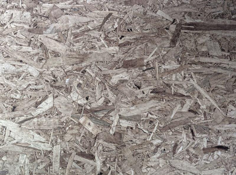 Piccoli pezzi di compatto di legno, adatti a fondo immagine stock libera da diritti