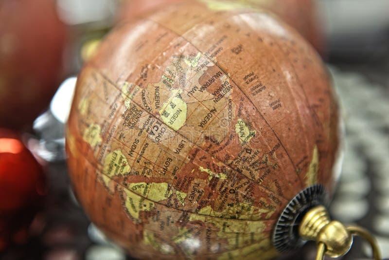 Piccoli supporti antichi decorativi del globo fotografia stock