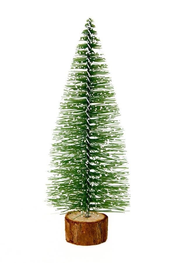 Piccolo albero di Natale artificiale decorativo su un fondo bianco immagine stock libera da diritti