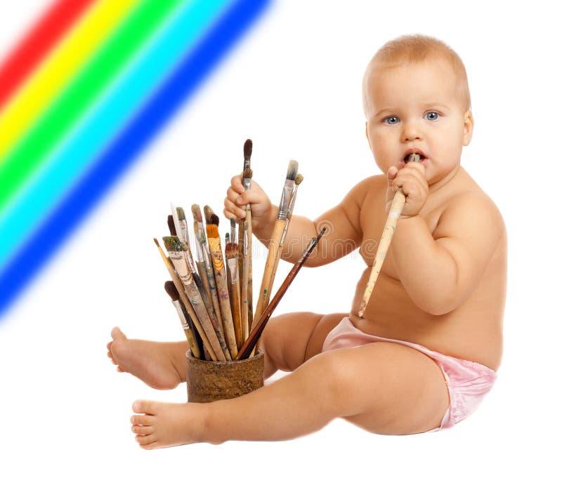 Piccolo bambino con i pennelli immagine stock libera da diritti