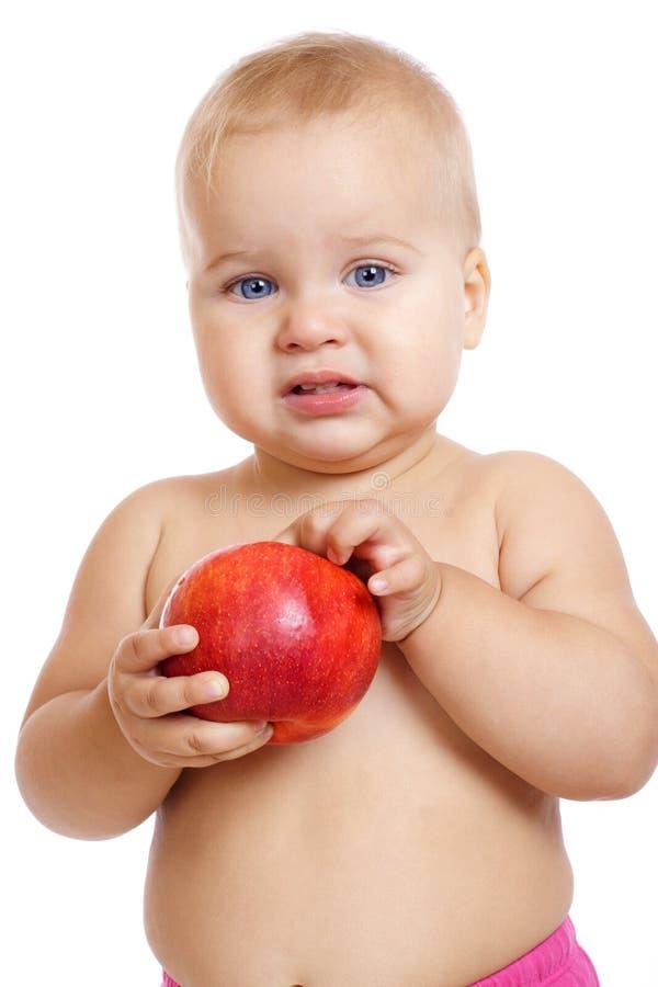 Piccolo bambino con la mela fotografie stock libere da diritti