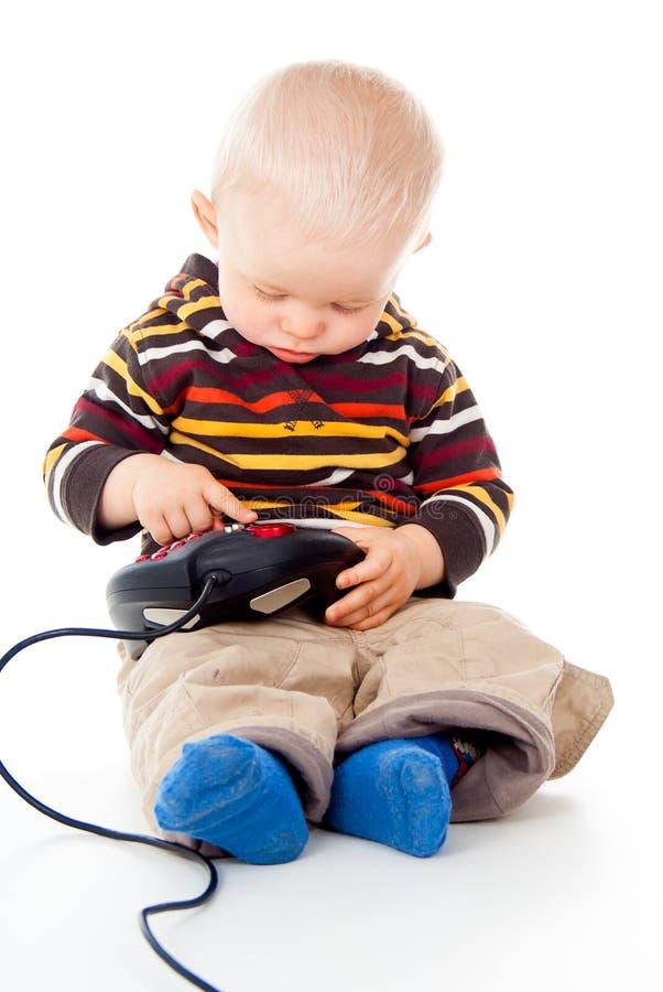 Piccolo bambino con una leva di comando fotografie stock libere da diritti