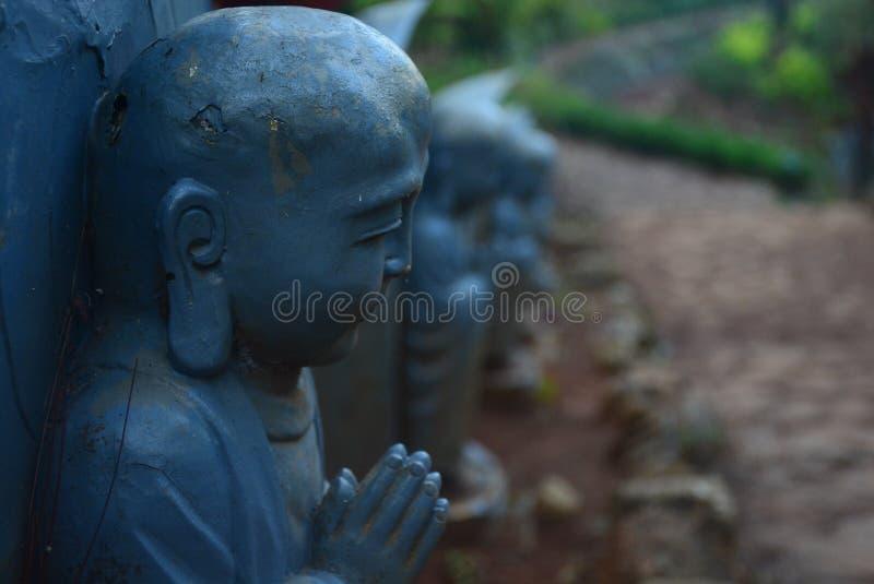 Piccolo Buddha pregante fotografia stock