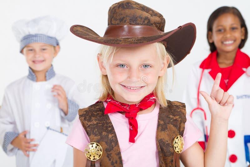 Piccolo cowgirl sveglio fotografia stock