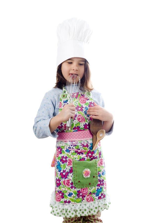 Piccolo cucina la ragazza immagini stock libere da diritti