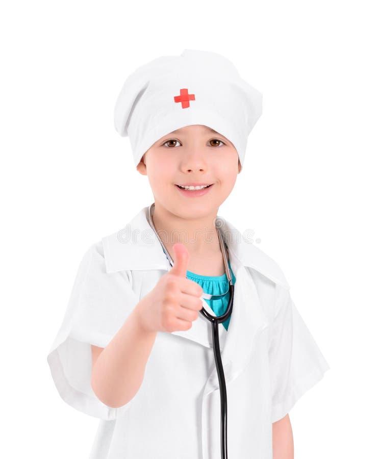 Piccolo medico sorridente che mostra pollice su immagine stock libera da diritti