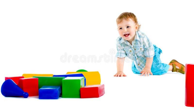 Piccolo neonato sveglio con la particella elementare variopinta fotografia stock libera da diritti