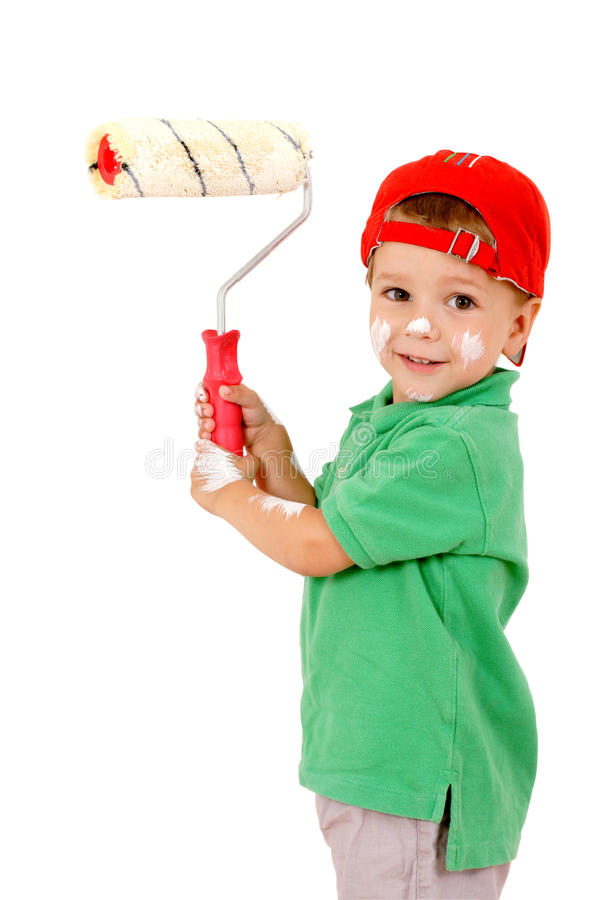 Piccolo operaio con paintroller fotografia stock