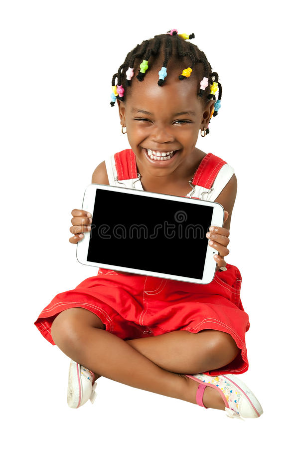 Piccolo pc afroamericano della compressa della tenuta della ragazza immagine stock libera da diritti