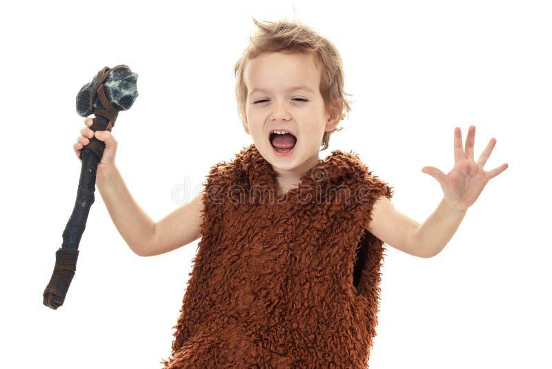 Piccolo ragazzo divertente neandertaliano o Ass.Comm.-Magnon testo del ritratto fotografia stock libera da diritti