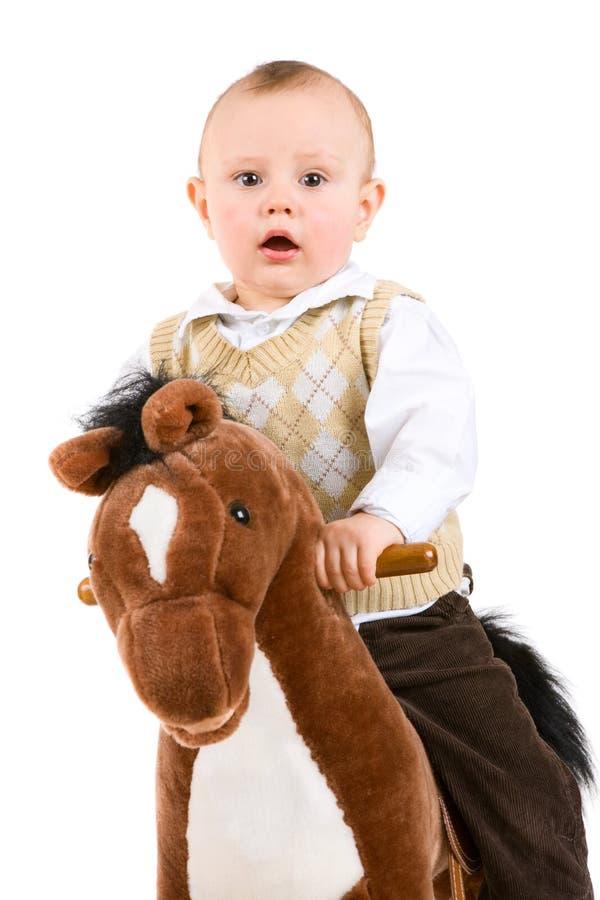 Piccolo ragazzo sul cavallo fotografie stock