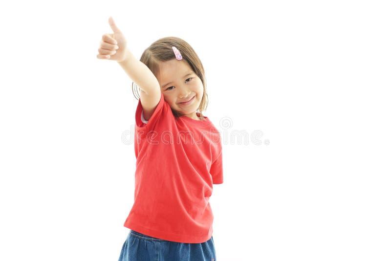 Piccolo sorridere asiatico sveglio della ragazza immagini stock