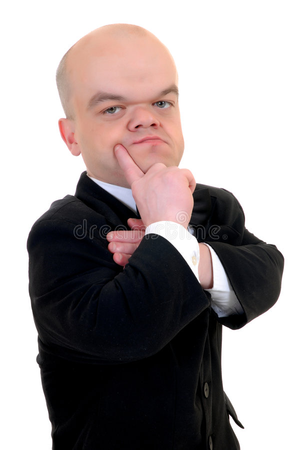 Piccolo uomo d'affari disturbato fotografia stock libera da diritti