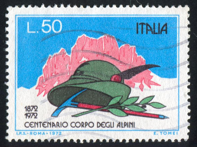 Pick and laurel. ITALY-CIRCA 1972: stamp printed by Italy, shows Mountains, Alpinist`s hat, pick and laurel, circa 1972 stock image