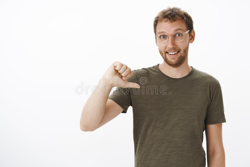 Pick me you would not regret choice. Portrait of ambitious energized good-looking male coworker in dark-green t-shirt. Pointing at himself while volunteering to royalty free stock photography