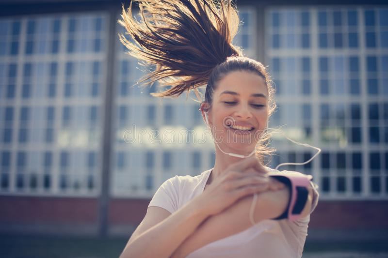 Pick a motivation music and go for. Sports person stock photo