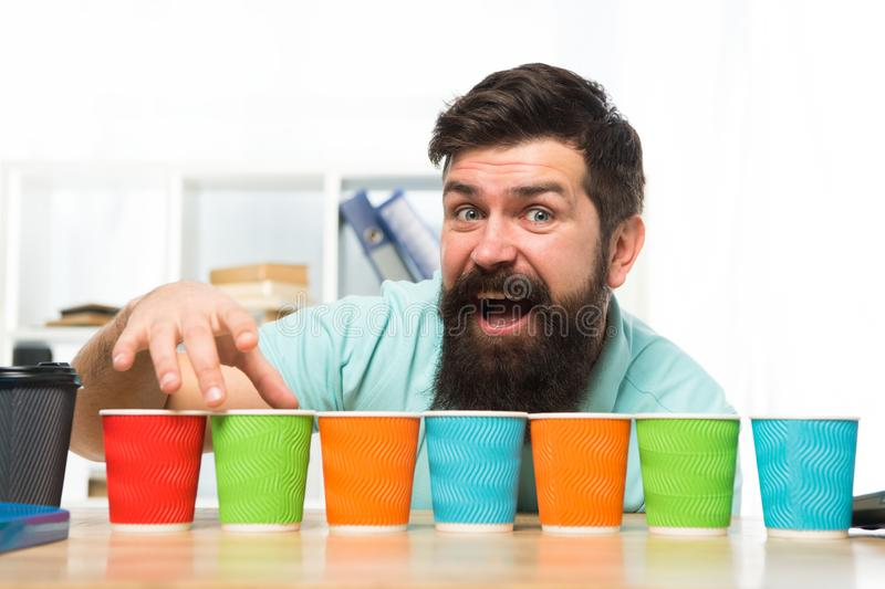 Pick one. Diversity and recycling. Eco paper cup. Coffee to go paper cup. How many cups per day. Choose from. Alternatives. Man bearded choosing one of lot stock image
