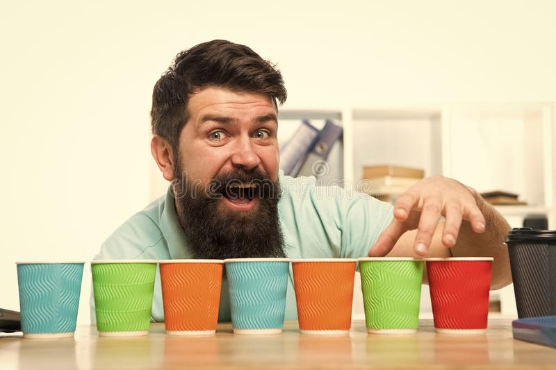 Pick one. Diversity and recycling. Eco paper cup. Coffee to go paper cup. How many cups per day. Choose from. Alternatives. Man bearded choosing one of lot royalty free stock images