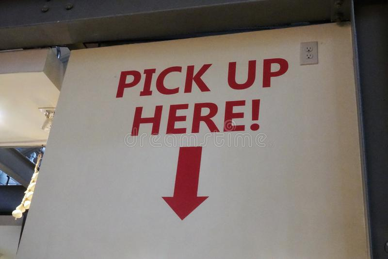Pick up here sign at a restaurant stock photos