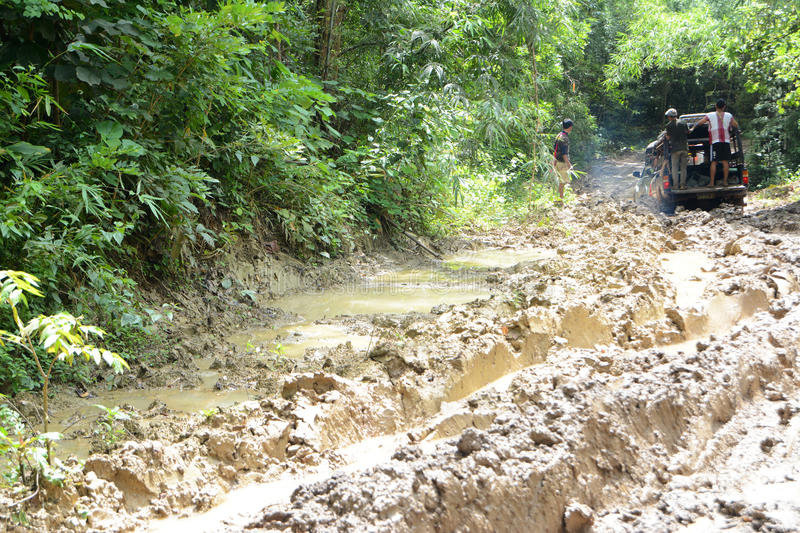 Pick up in Mud road. Pickup in Mud road after many rainy days on the way to Tee Lor SU waterfall, Tak, Thailand royalty free stock photos