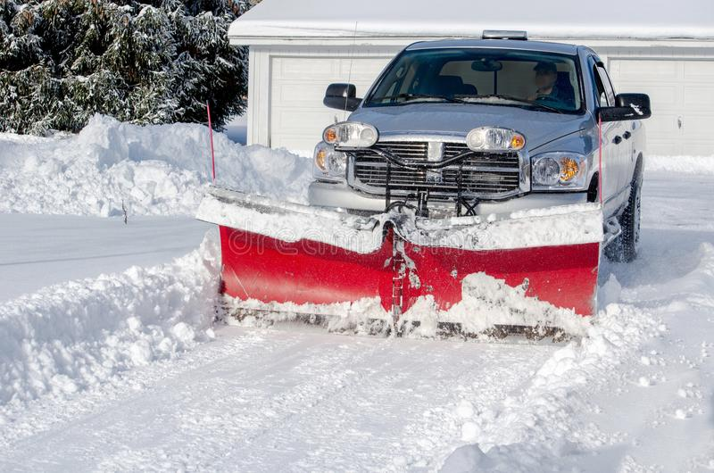 clearing snow in a residential area stock photography