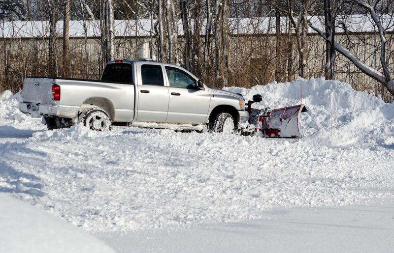 Moving lots of snow on a cold winter day royalty free stock photography