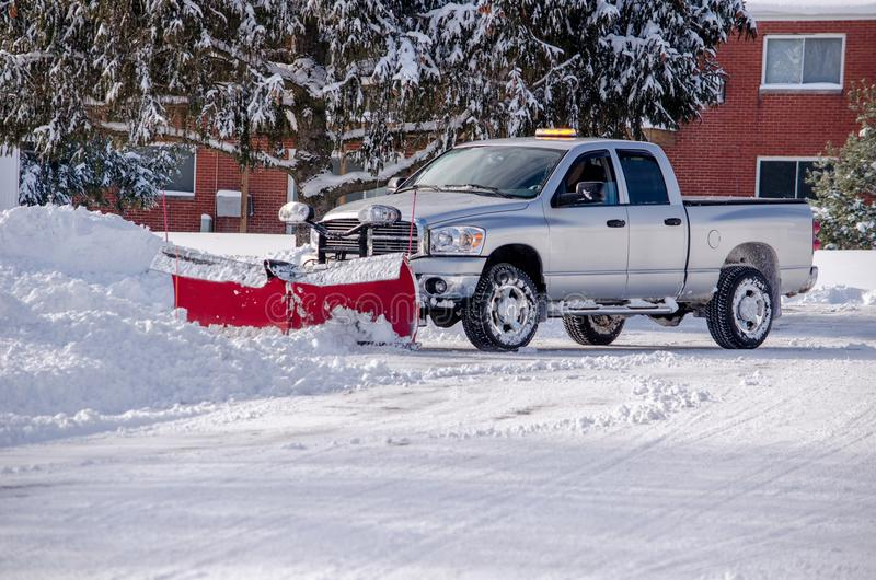 Plowing snow after a big storm royalty free stock image
