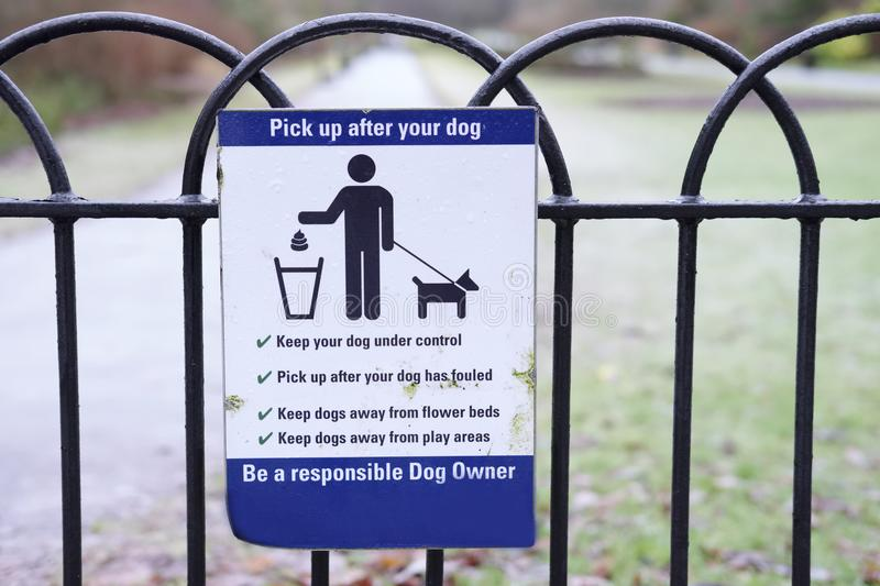 Pick Up Dog Mess Waste Sign in Public Countryside Park royalty free stock image