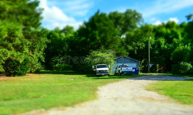 Pick-ups and an old wooden house. Rural Life in Texas, USA royalty free stock photography