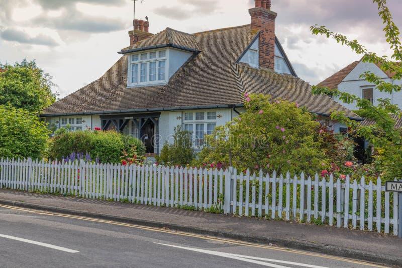 Picket fence cottage stock image