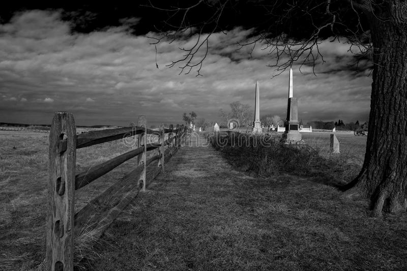 Picket line, Gettysburg, PA. Picket line with monuments along battlefield in Gettysburg, PA in black and white royalty free stock image