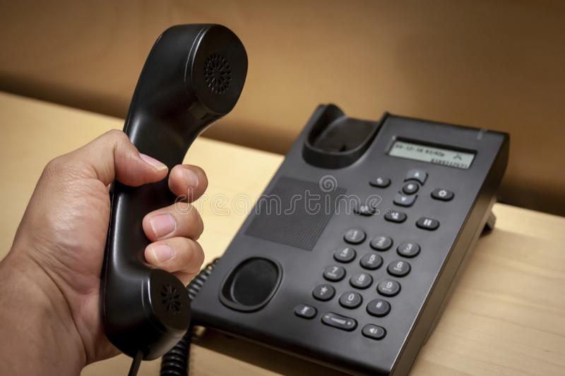 Picking up a call in a black phone stock photography