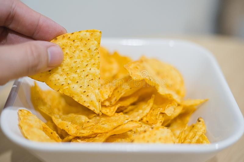 Picking up corn chip royalty free stock image